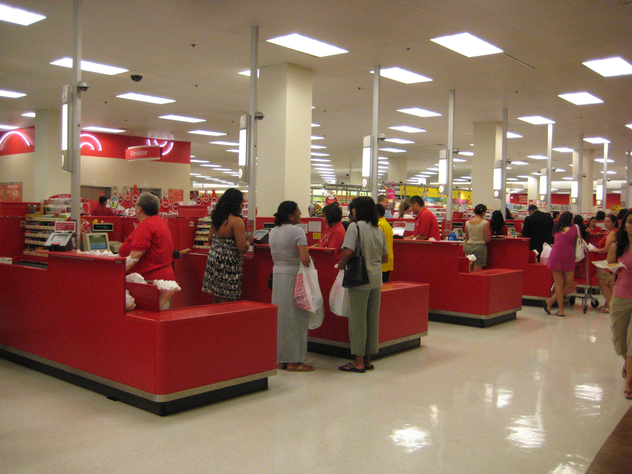 Cashiers ringing up sales