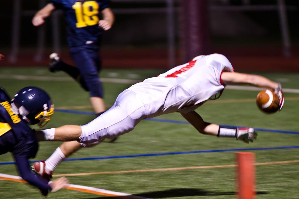 Kirby Roeder dives into the end zone for a touchdown (Photo by Marcy Zitz)