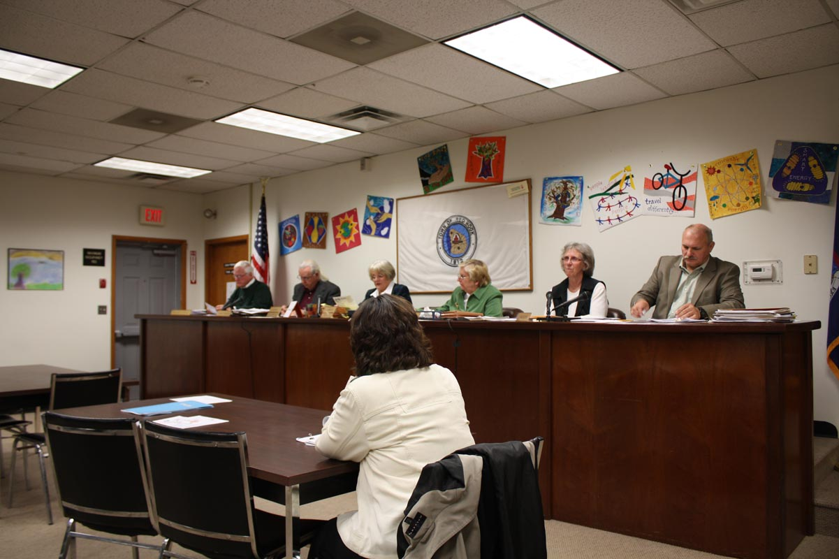 From left to right in back: Councilman Bill O'Neill, Councilman Harry Colgan, Supervisor Sue Crane, Town Clerk Sue McCann, Councilwoman Brenda Cagle and Councilman Bill Ross. In foreground, town attorney Christine Chale