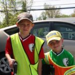 Benjamin Finch, 7, and his brother Matthew, 5, prepare to head out for street trash pickup. Photo by Kristofer Munn