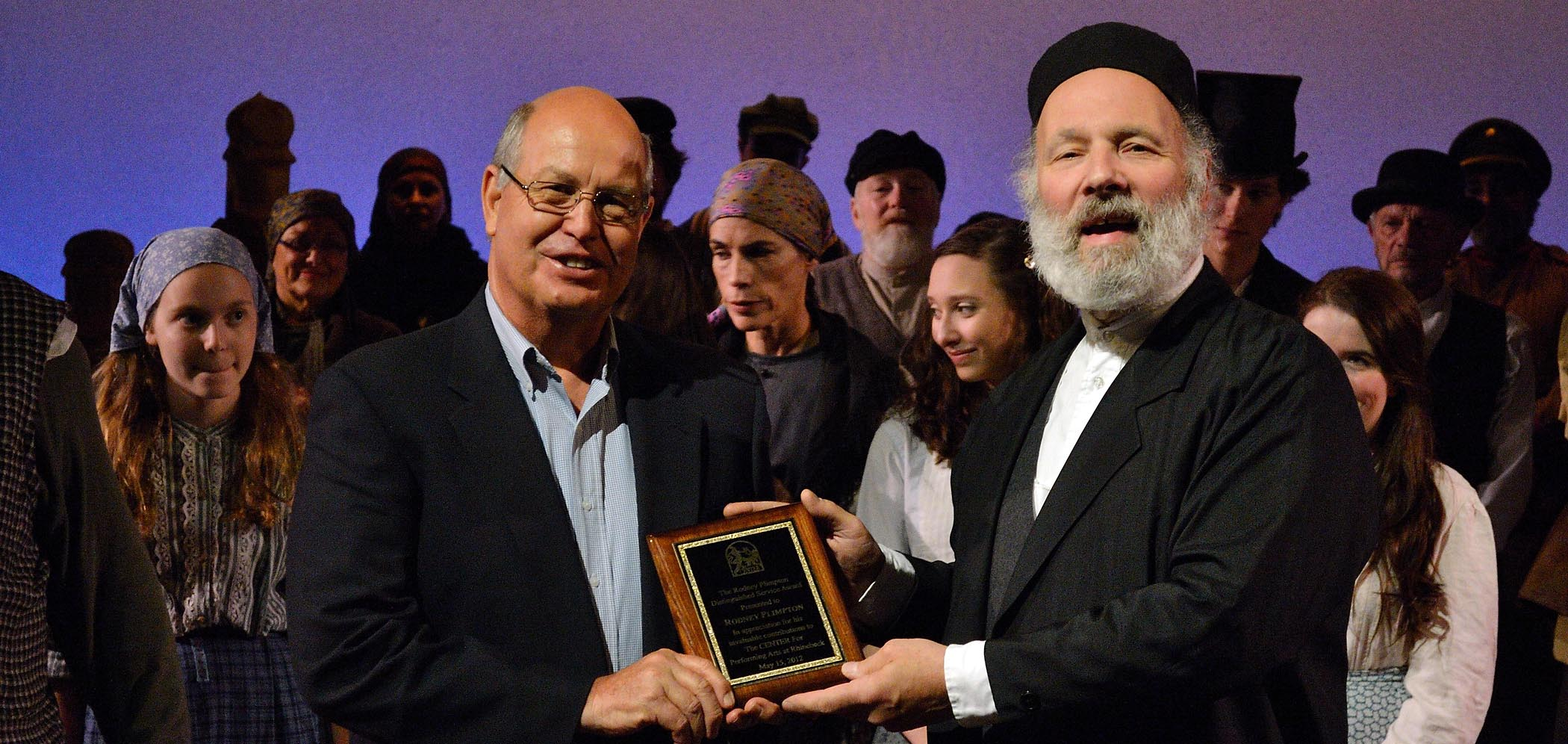 "Rodney Plimpton (left) accepts award for distinguished service from Board President Andy Weintraub during the final curtain call for ""Fiddler on the Roof."" Photo by JoAnne Contreni"