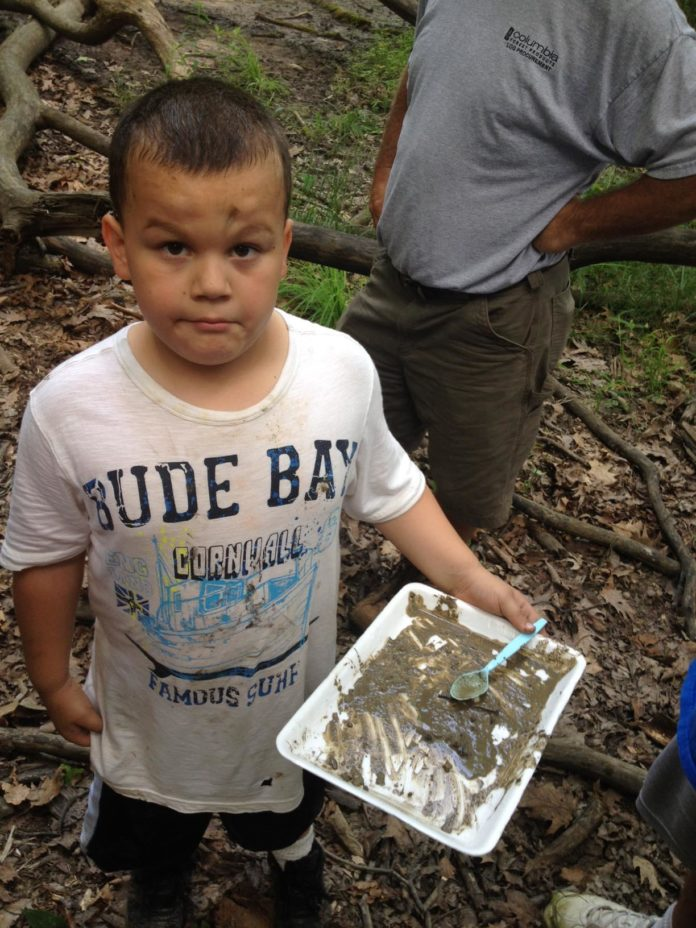Cub Scout Brayden Hayes searching for critters at Poet's Walk