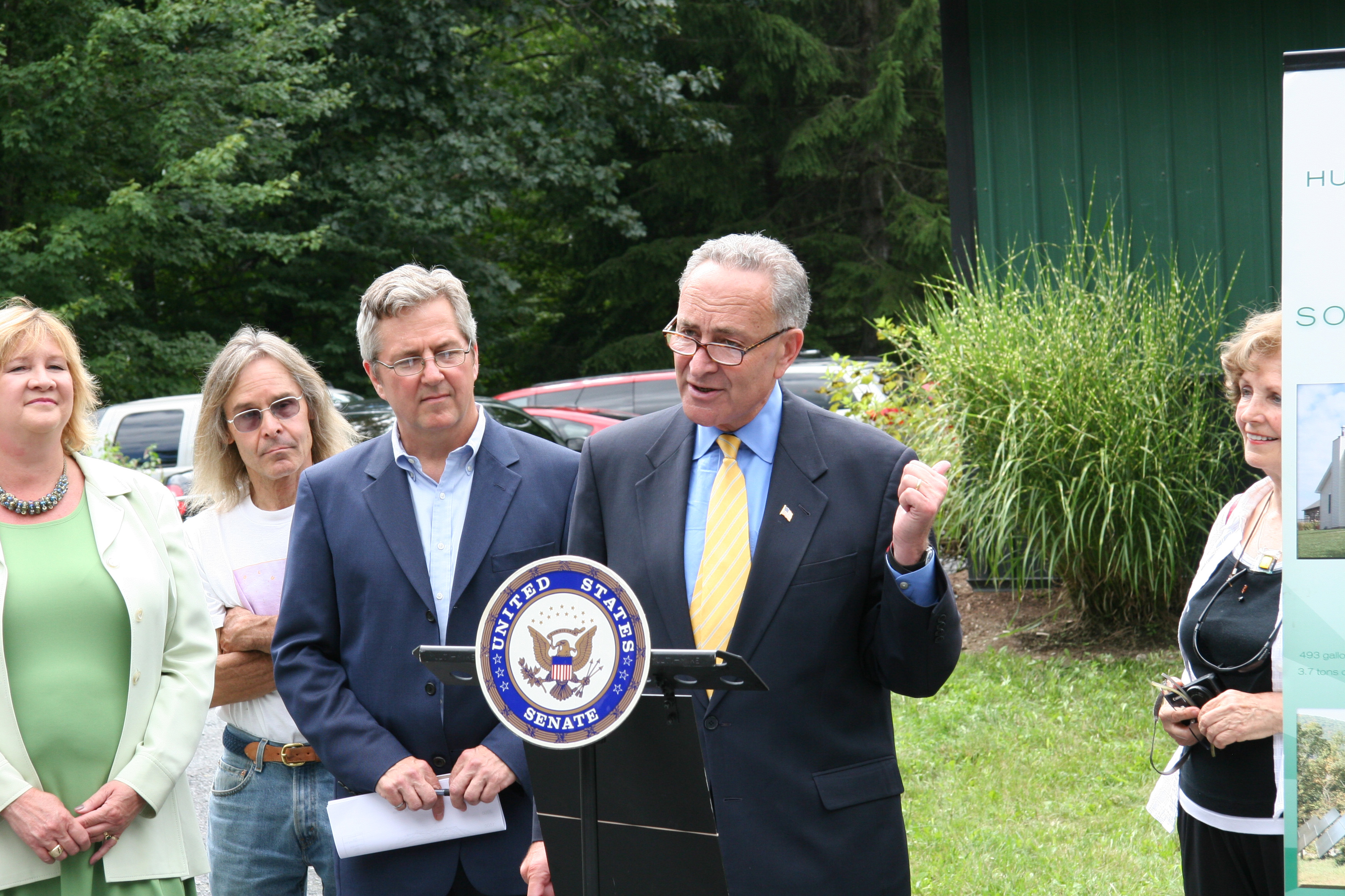 U.S. Senator Charles Schumer (right) and Hudson Solar president Jeff Irish (center) discussed the ramifications of capping net-metering.