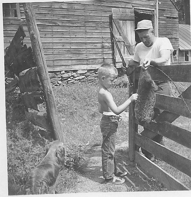 Joe Van Steenburgh shows off his latest woodchuck to an admiring, aspiring would-be hunter, circa 1951.