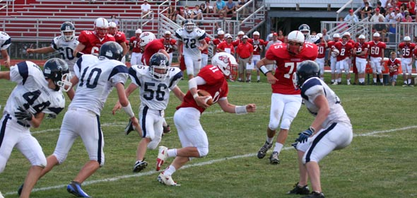 QB Lucas Brochetti (#11) delivered on the ground and through the air in Red Hook's victory over Pine Plains, Sept. 2012.