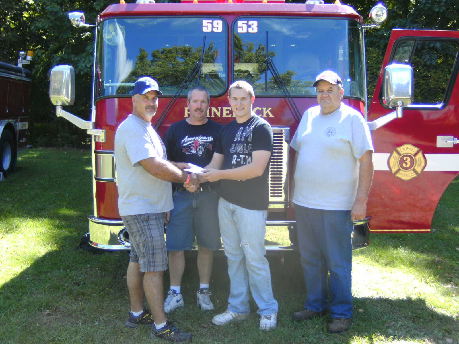 Caption: (L to R): Treasurer John Imperato, Chief Rick Dorrer, Devon Dorrer,  President Bill Stroka