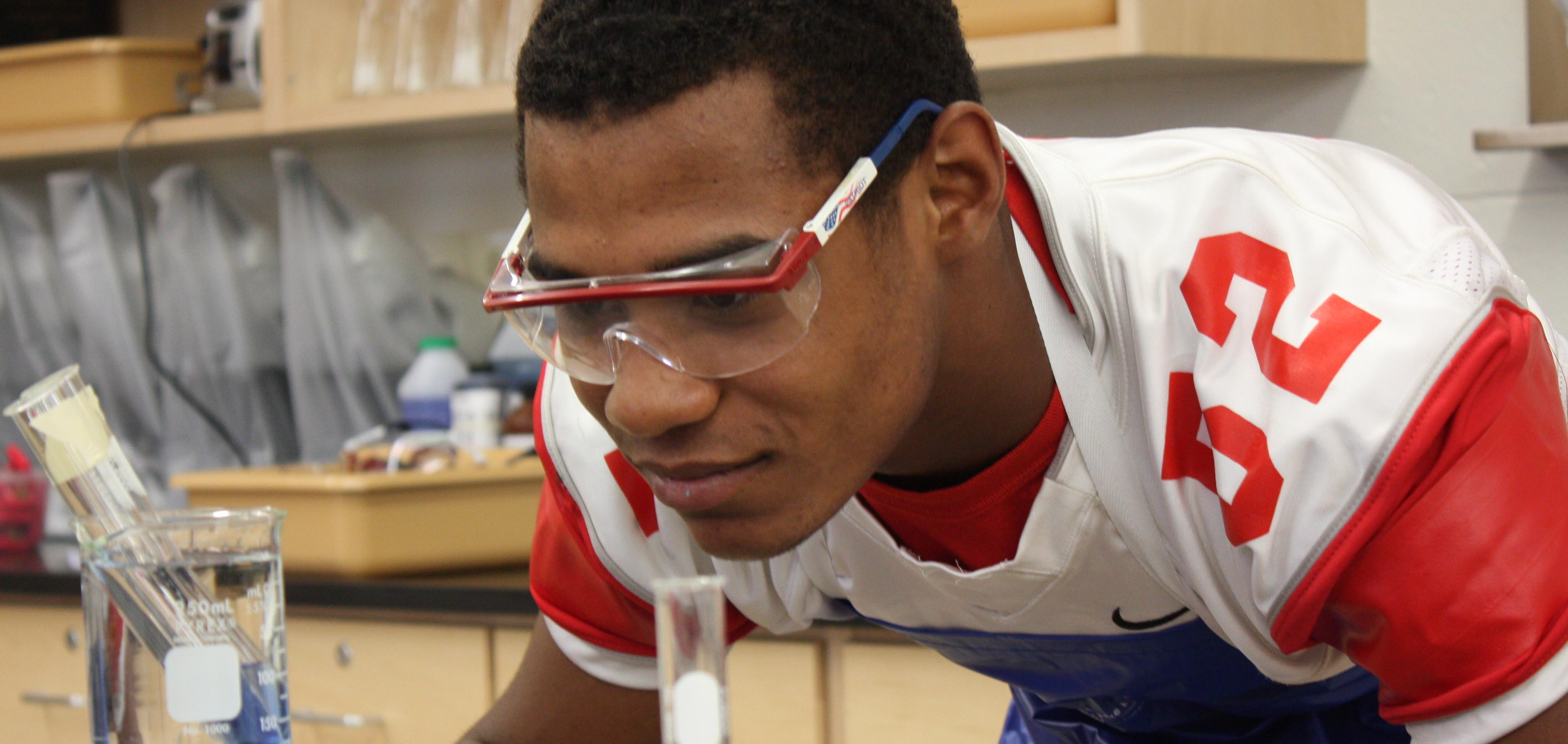 Student Tim Terry watches his experiment in a newly renovated science lab at Red Hook High School.