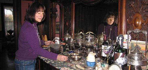 Beth Pagano arranges the dining room sideboard