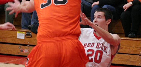Nick Michitsch (#20) tries to pass from his knees during the Red Hook vs Marlboro game on Jan. 11.