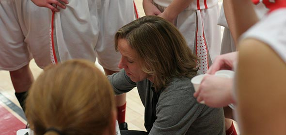Coach Pam White advises her team during Red Hook's win over New Paltz.