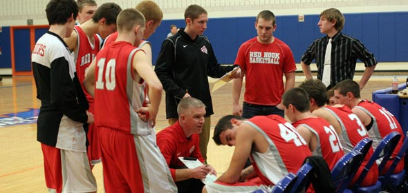 Coach Matt Hayes speaks to his team during a timeout.