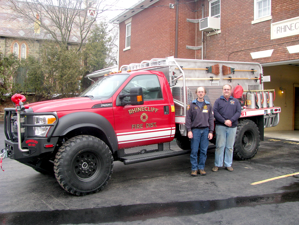 A special thanks to Chief Rich Kipp (left), Bill Cotting and Jeff Hicks (not present) for their expertise, research and perseverance in obtaining a new 2012 Firematic Brush Rapid Attack brush truck for Rhinecliff.