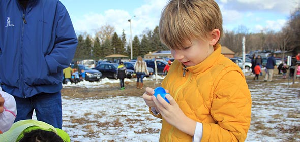 Owen Oleszewski of Rhinebeck cracks open a plastic egg to see what goodies are contained inside.