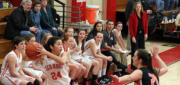 A look back at 2012: Coach Pam White (standing in red) and the Red Hook bench watch in the final minutes as Kyla Gabriel (#24) looks to make something happen on offense against a tough Marlboro squad.