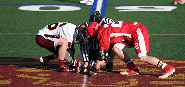 Red Hook's John Alessi (right) prepares for the face-off against Kingston's Quinn Baganz.