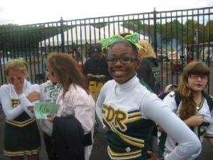 Full of Good Cheer: Eighth grade cheerleader Marqui Land was all smiles at the grand opening of FDR High School's new athletic complex.