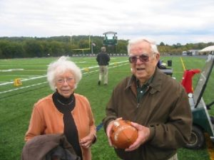 Pure Gold:  Looking like he was ready to center the pigskin once again, Class of '41's John Golden was honored by the 2013 varsity football team during pre-game ceremonies at the FDR High School sports complex. His wife of 63 years, Gloria, shared his special moment.