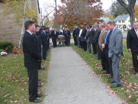 "Over 50 former players and coaching partners lined the sidewalk into Regina Coeli Roman Catholic Church for the funeral of Coach Duane Davis, who was eulogized as a ""Man of Integrity"" and a special guiding force for many of those in attendance Saturday, Nov.9."