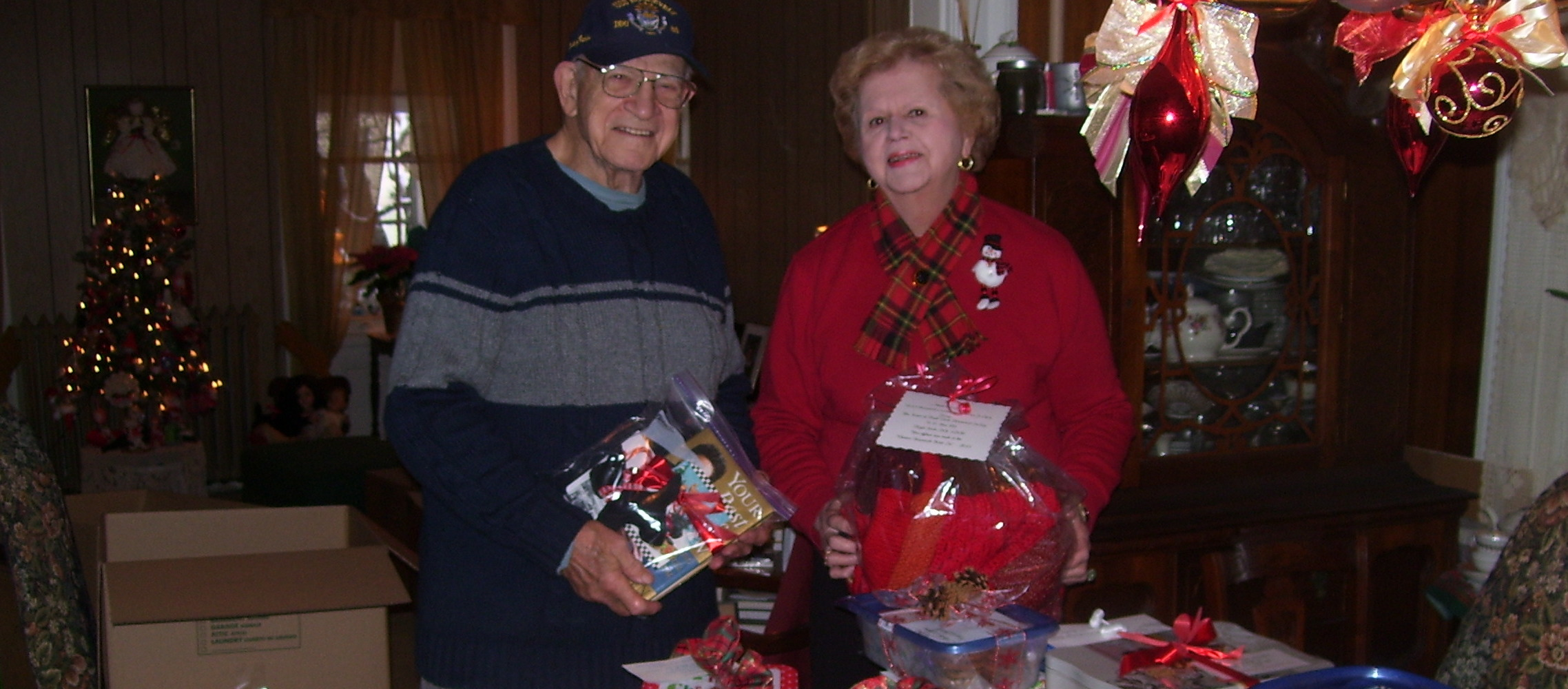 Ralph Osterhoudt, Sr. & Patsy N. Costello -- Cookies being sent to the USS Roosevelt DDG 80 from the Town of Hyde Park Historical Society