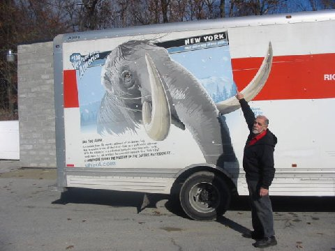 Al Rand, who rents U-Haul vans and trucks at his Inspection Shop on Route 9G, had a recent surprise visit from the Hyde Park mastodon, which arrived on the side of Van #108 in the U-Haul series depicting national landmarks and historic events.