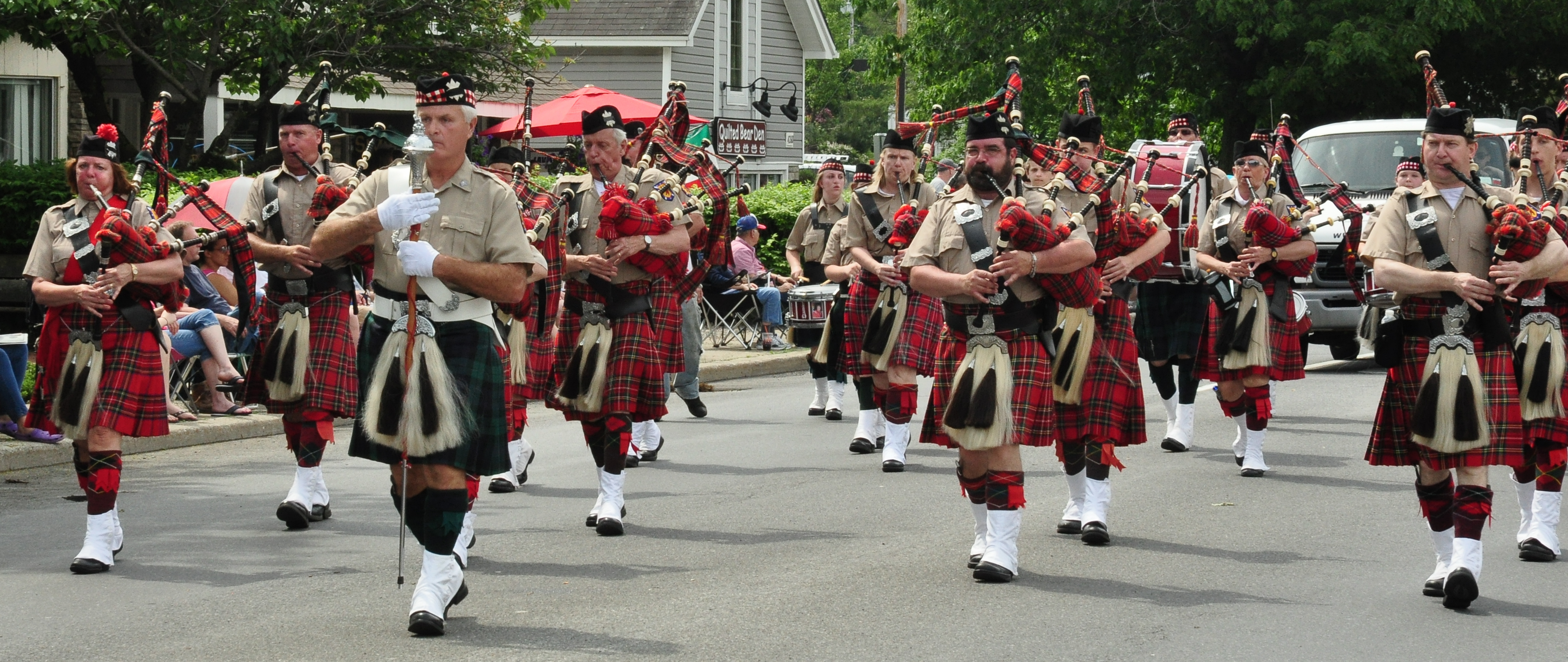 Band members Janet Whalen, far left, William Moriarty, Bill Tompkins, Wayne Merrick, David Allan, and Dan Kearney march in Hyde Park in 2012. Courtesy Photo / Alnwick Photography