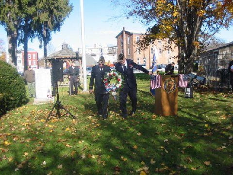 Commander Michael Athanas of American Legion Post 1303 joined veteran Ralph Osterhoudt, Sr. in placing a wreath in front of the Hyde Park Veterans Memorial on the grounds of Town Hall as part of the 2013 Veterans Day ceremony.  Bob Kampf/The Observer