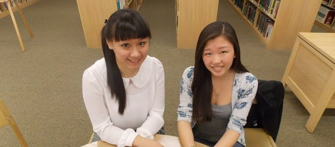 Jenny Wu (left), a Rotary Club exchange student from Taiwan, shares notes in FDR High School with Su Xion Dickey of Hyde Park, who spent the 2012–13 school year as an exchange student in Taiwan. Bob Kampf / The Observer
