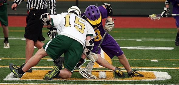 FDR midfielder Tom Stritt (#15) faces off during the matchup against Rhinebeck on April 1. Quinn O'Callaghan / The Observer