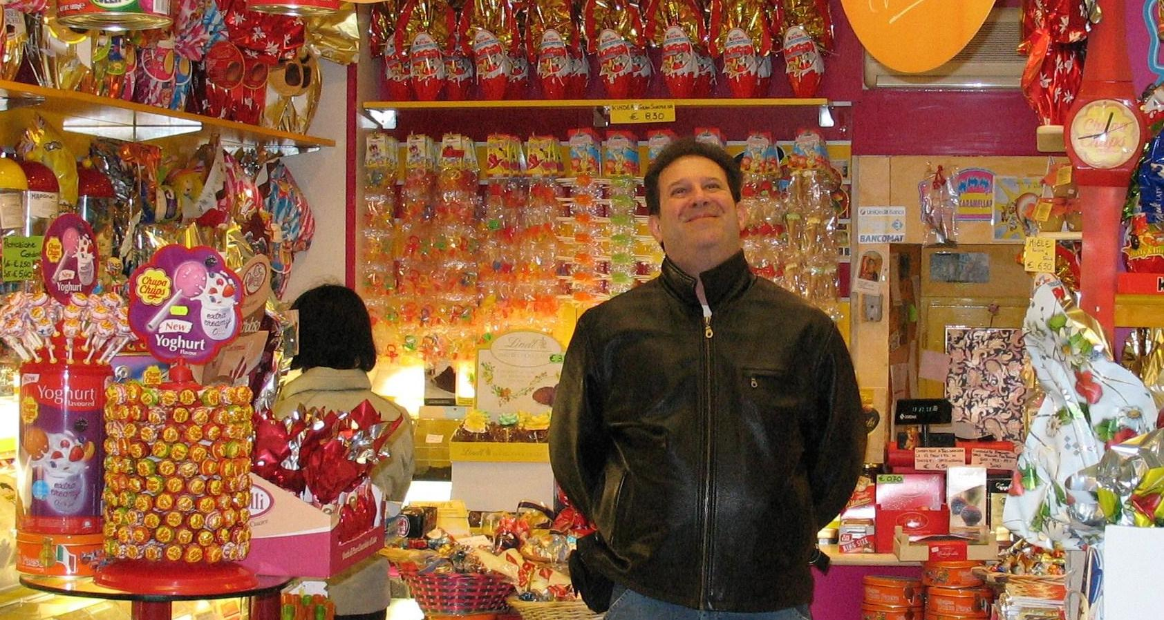 Ira Gutner is surrounded by sweets at a candy store in Italy in March 2007. Courtesy Photo / John Schwartz