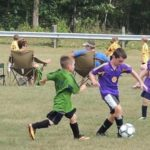 Andrew Plant and the Cheetahs (purple) chase the ball. Photo courtesy of Hyde Park Soccer League.