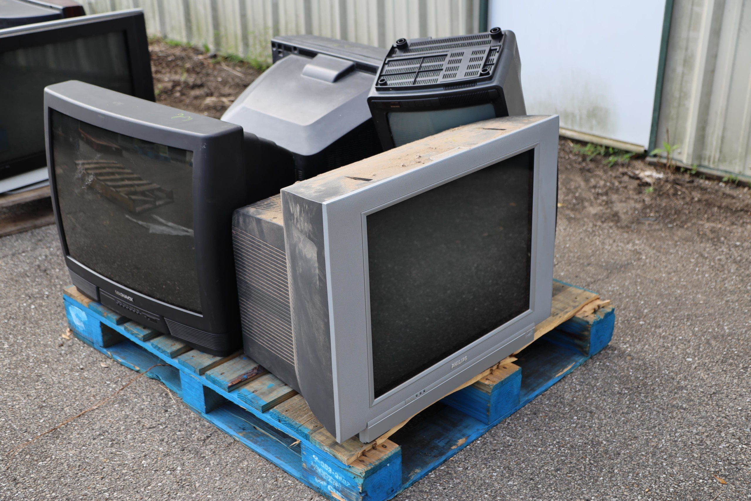 Old TVs on a pallet