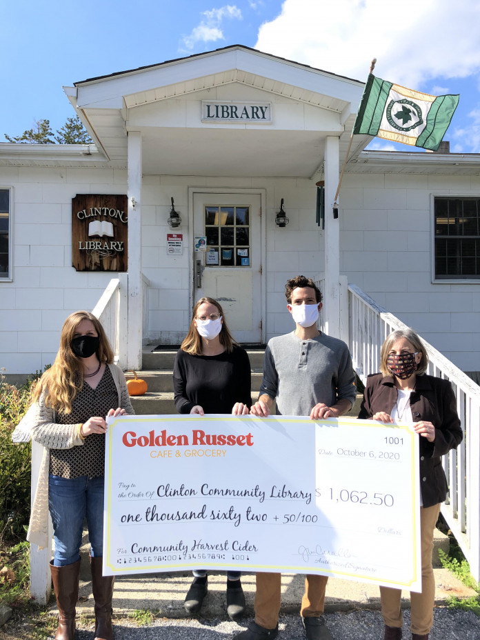 The Cavallos present their donation check to the Clinton Library on October 6. (L to r) Carol Bancroft, Library Director; Jenny & Craig Cavallo, co-owners Golden Russet Cafe & Grocery; Mary Pat Sternberg, Clinton Library Board of Trustees President